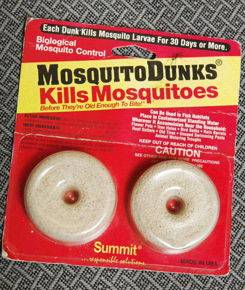 Photo - A package of mosquito dunks at the OSU Extension office in Oklahoma City Wednesday, May 22, 2013.  Photo by Paul B. Southerland, The Oklahoman
