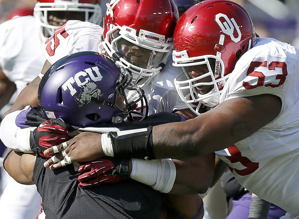 tou85nd/ and Casey Walker (53) bring down TCU's Trevone Boykin (2) during a college football game between the University of Oklahoma Sooners (OU) and the Texas Christian University Horned Frogs (TCU) at Amon G. Carter Stadium in Fort Worth, Texas, Saturday, Dec. 1, 2012. Oklahoma won 24-17. Photo by Bryan Terry, The Oklahoman