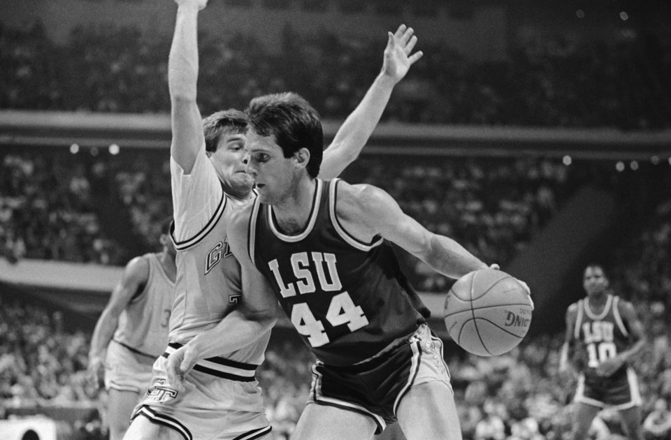Photo - LSU's Don Redden (44) moves the ball past Mark Price of Georgia Tech during on Thursday night, March 21, 1986  NCAA southeast regional basketball action at the Omni in Atlanta. LSU won and will meet Kentucky on Saturday for southeast regional final. (AP Photo)