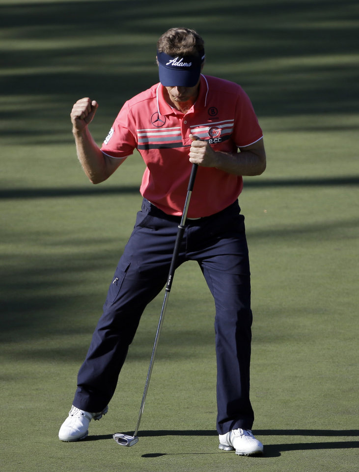 Photo - Bernhard Langer, of Germany, pumps his fist after a birdie on the 15th hole during the first round of the Masters golf tournament Thursday, April 10, 2014, in Augusta, Ga. (AP Photo/David J. Phillip)