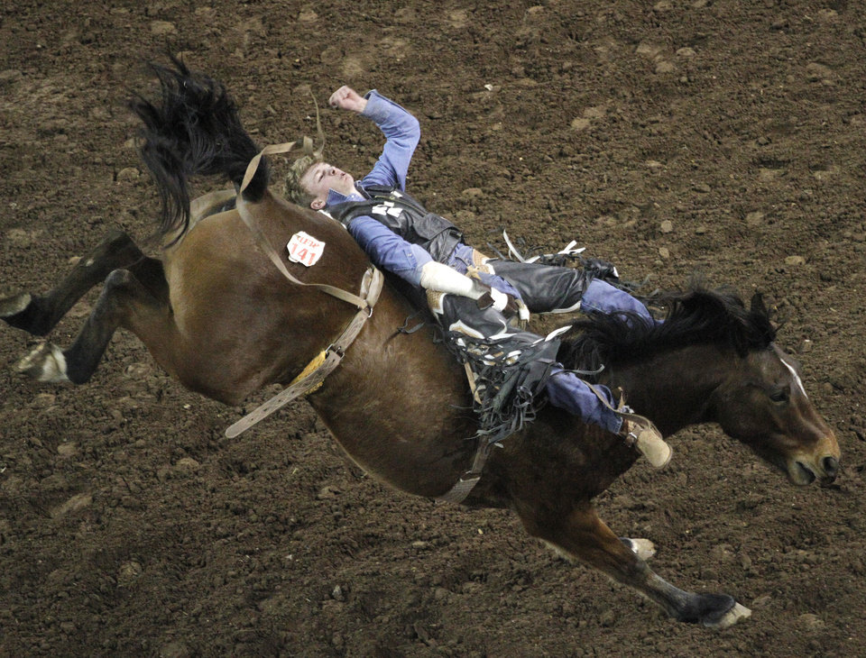 Mark Kreder, of Collinsville, Okla., competes in Bareback Bronc during the final performance of International Finals Rodeo at the State Fair Arena in Oklahoma City, Okla., Sunday, Jan. 20, 2013.  Photo by Garett Fisbeck, For The Oklahoman