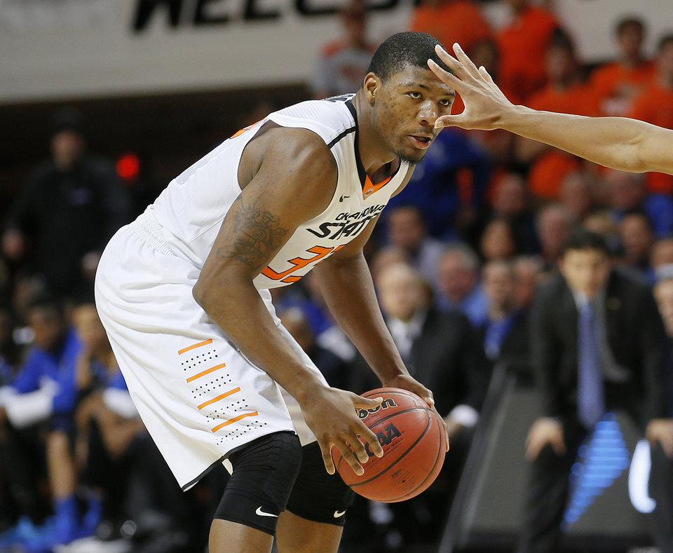 Photo -  Oklahoma State's Marcus Smart (33) looks towards the basket during an NCAA college basketball game between Oklahoma State and Memphis at Gallagher-Iba Arena in Stillwater, Okla., Tuesday, Nov. 19, 2013. Photo by Bryan Terry, The Oklahoman