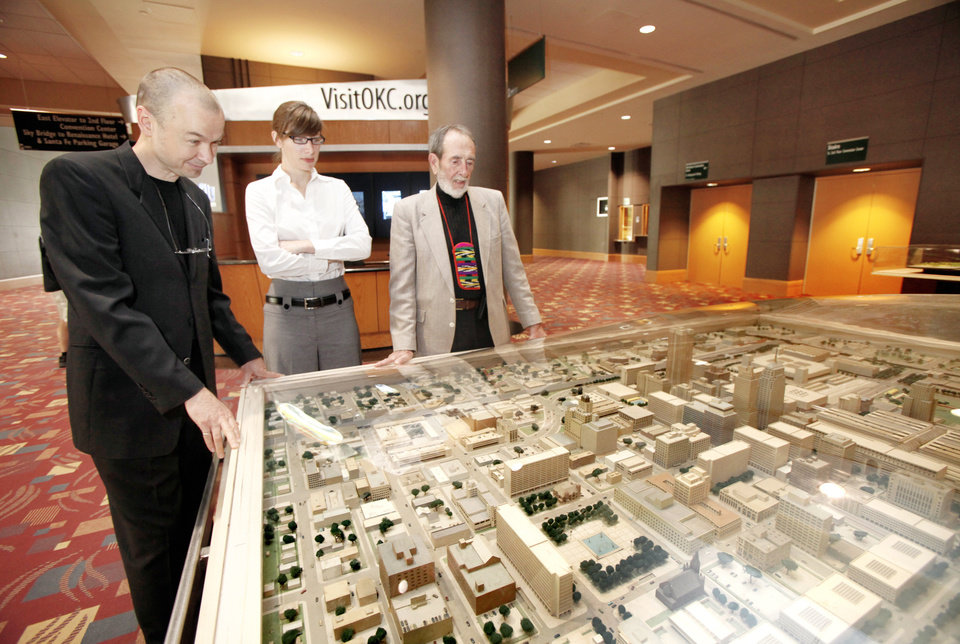 Hans Butzer, left, Rachel Mosman and Arn Henderson look at the I.M. Pei Model of Oklahoma City on Friday. Photo by Steve Gooch, The Oklahoman