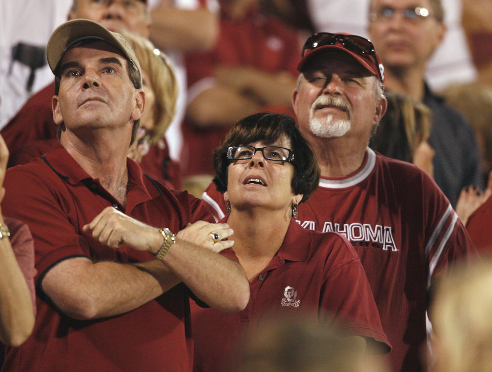 Photo - Sooner fans watch the replay during the second half of the college football game between the University of Oklahoma Sooners (OU) and Utah State University Aggies (USU) at the Gaylord Family-Oklahoma Memorial Stadium on Saturday, Sept. 4, 2010, in Norman, Okla.   Photo by Steve Sisney, The Oklahoman