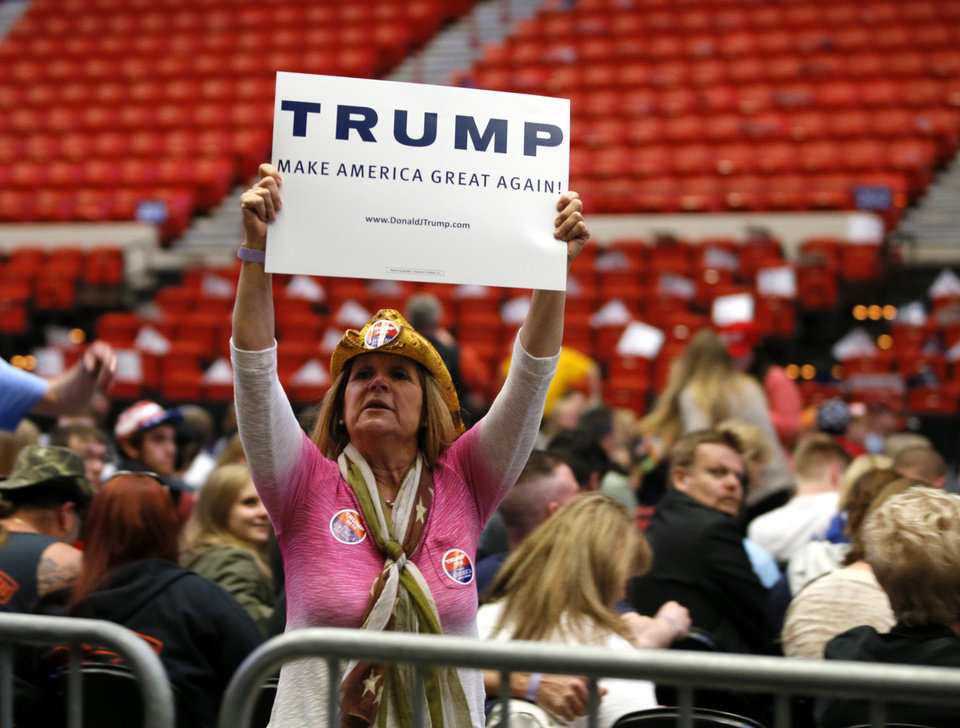 Photo - A Donald Trump supporter holds a sign before a rally for Republican presidential candidate Donald Trump at the Cox Convention Center in Oklahoma City, Friday, Feb. 26, 2016. Photo by Bryan Terry, The Oklahoman