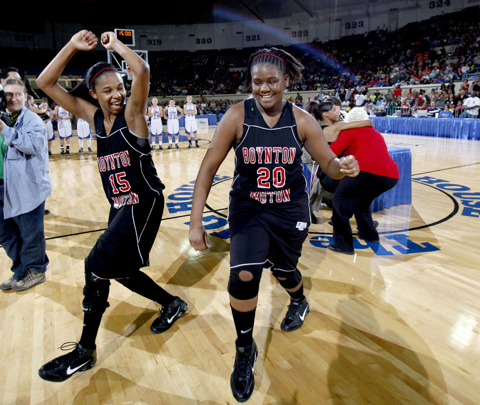 Photo - Boynton-Moton's Sherri Lang, left, and Shawonda Lang celebrate their win over Cyril in the final of the Class B girls basketball state tournament  at the State Fair Arena, Saturday, March 6, 2010, in Oklahoma City. Photo by Sarah Phipps, The Oklahoman