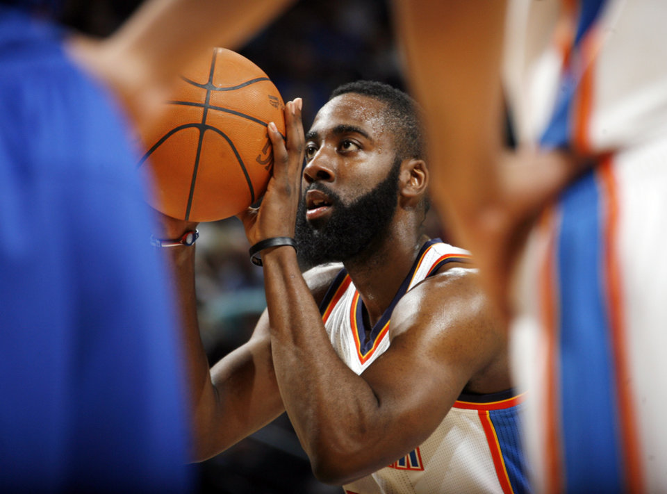 James Harden (13) of Oklahoma City shoots a free throw during an NBA basketball game between the Oklahoma  City Thunder and the Detroit Pistons at the OKC Arena in Oklahoma City, Friday, March 11, 2011.  Oklahoma City won, 104-94. Photo by Nate Billings, The Oklahoman