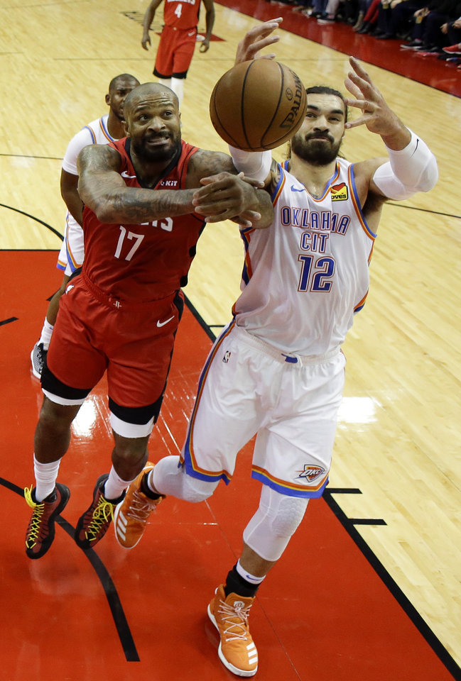 Photo - Houston Rockets forward PJ Tucker (17) and Oklahoma City Thunder center Steven Adams vie for rebound during the first half of an NBA basketball game, Monday, Oct. 28, 2019, in Houston. (AP Photo/Eric Christian Smith)