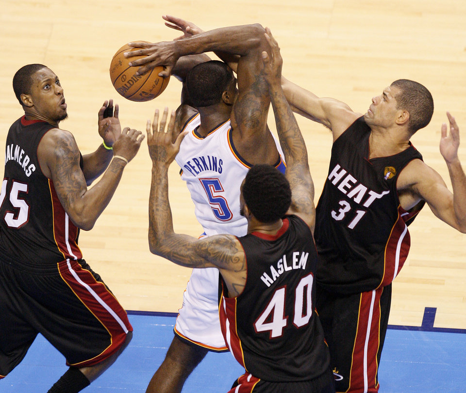 Oklahoma City's Kendrick Perkins (5) is trapped by Miami's Mario Chalmers (15), Udonis Haslem (40), and Shane Battier (31) during Game 2 of the NBA Finals between the Oklahoma City Thunder and the Miami Heat at Chesapeake Energy Arena in Oklahoma City, Thursday, June 14, 2012. Photo by Nate Billings, The Oklahoman