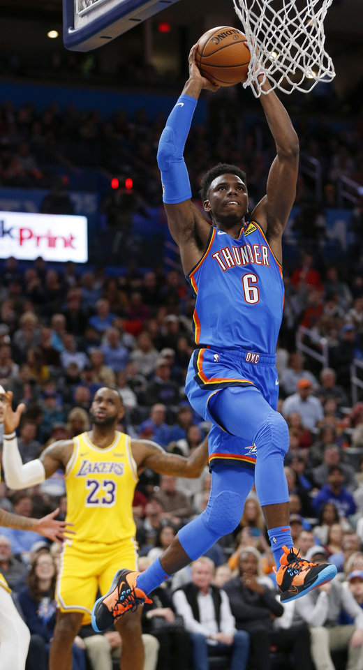 Photo - Oklahoma City's Hamidou Diallo (6) dunks the ball in the second quarter as Los Angeles' LeBron James (23) watches during an NBA basketball game between the Oklahoma City Thunder and the Los Angeles Lakers at Chesapeake Energy Arena in Oklahoma City, Friday, Nov. 22, 2019. [Nate Billings/The Oklahoman]