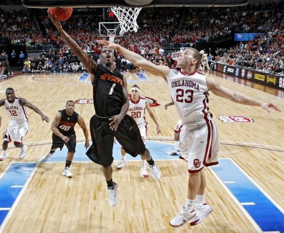 Photo - Oklahoma State's Terrel Harris (1) shoots the ball over Oklahoma's Blake Griffin (23) in the second round game of the Big 12 Men's Basketball Championships between The University of Oklahoma and Oklahoma State University at the Ford Center on Thursday, March 12, 2009, in Oklahoma City, Okla. PHOTO BY CHRIS LANDSBERGER, THE OKLAHOMAN