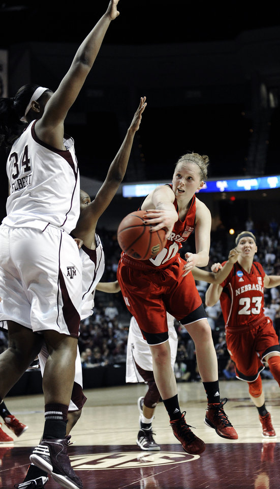 Photo - Nebraska's Lindsey Moore (00) tries to maintain control of the ball under pressure from Texas A&M's Karla Gilbert (34) during a second-round game in the NCAA women's college basketball tournament in College Station, Texas, Monday, March 25, 2013. Nebraska won 74-63. (AP Photo/Pat Sullivan)
