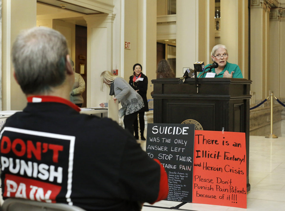 Photo -  Janet Segraves, a consultant with the Oklahoma Pain Society, speaks at the state Capitol on Tuesday at the Don't Punish Pain rally. [Photo by Jim Beckel, The Oklahoman]