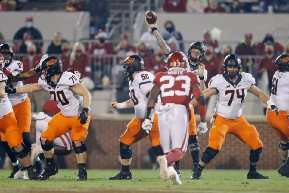 Photo -  Oklahoma State's Shane Illingworth (16) throws a pass during a Bedlam college football game between the University of Oklahoma Sooners (OU) and the Oklahoma State Cowboys (OSU) at Gaylord Family-Oklahoma Memorial Stadium in Norman, Okla., Saturday, Nov. 21, 2020. Oklahoma won 41-13. [Bryan Terry/The Oklahoman]