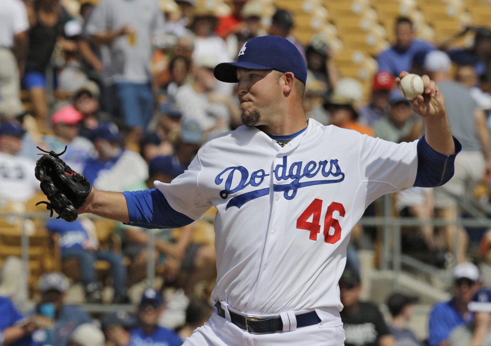 Photo - Los Angeles Dodgers starting pitcher Paul Maholm delivers against the Cincinnati Reds in a spring exhibition baseball game on Thursday, March 13, 2014, in Glendale, Ariz. (AP Photo/Mark Duncan)