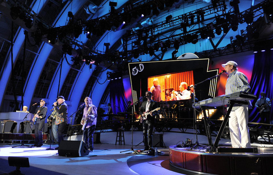 Photo -   FILE - In this June 2, 2012 file photo, The Beach Boys perform at the Hollywood Bowl in Los Angeles. Brian Wilson says he felt blindsided by a news release from his Beach Boys bandmate Mike Love that ended the good vibrations on the band's 50th anniversary tour. Wilson says the expectation was that both sides would help craft and approve the news release. That didn't happen and now he thinks it's Love's turn to reach out. (Photo by Chris Pizzello/Invision/AP, File)