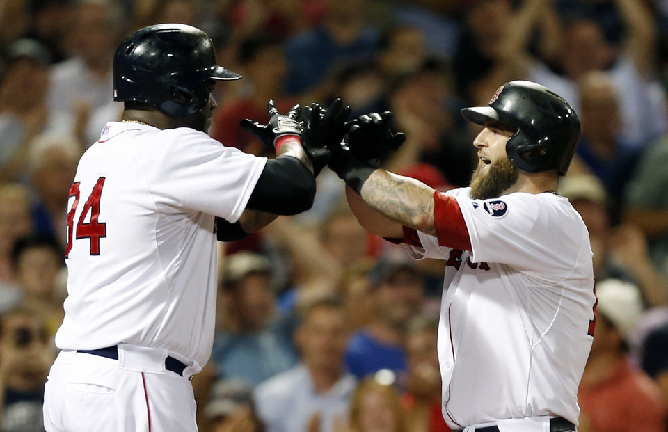 Photo - CORRECTS PERSON WHO HIT HOME RUN TO MIKE NAPOLI, INSTEAD OF JONNY GOMES - Boston Red Sox's Mike Napoli, right, celebrates his three-run home run with David Ortiz, left, who scored on the homer, in the third inning of a baseball game against the New York Yankees in Boston, Sunday, July 21, 2013. (AP Photo/Michael Dwyer)