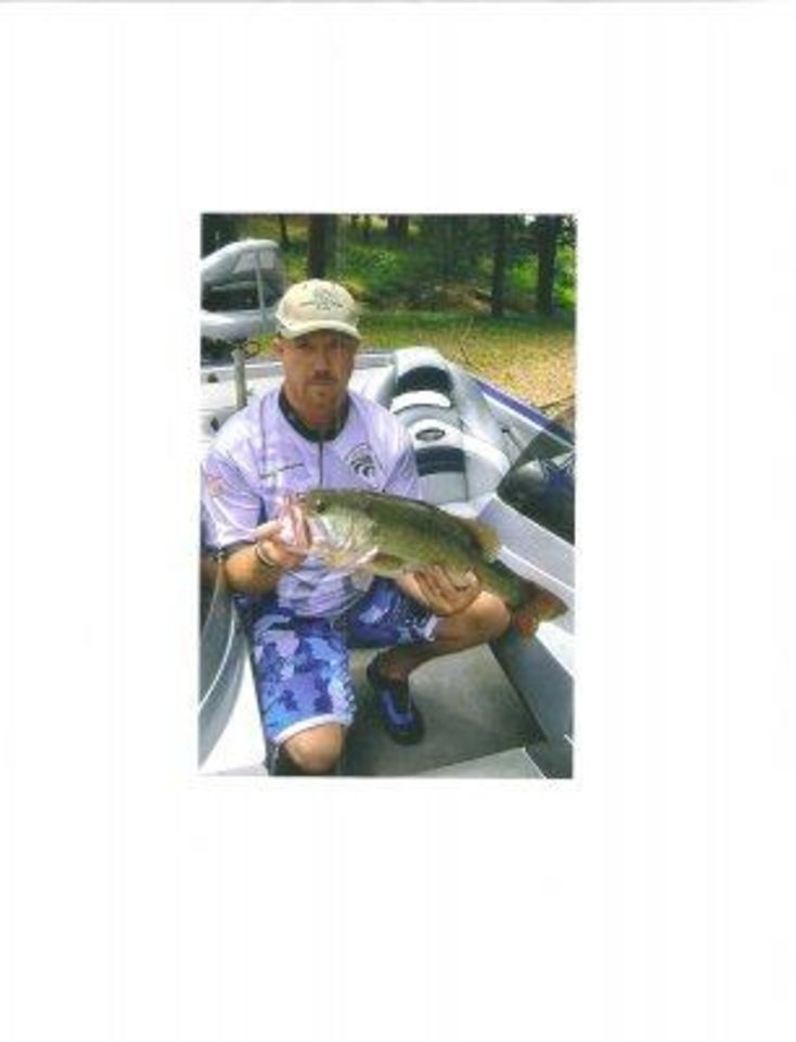 Photo -  Rodney Faulkenberry of Talihina with the new Sardis Lake record largemouth bass