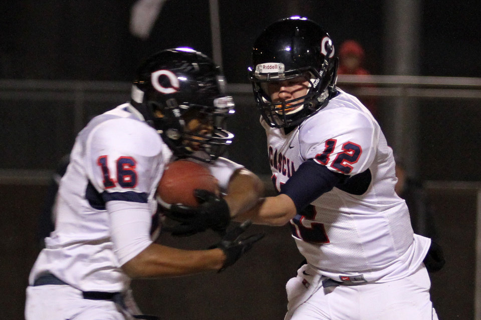 Photo - Cascia Hall quarterback Thomas Rouse hands the ball off to Abram McQuarters during the Class 3A quarter finals between Bethany and Cascia Hall in Bethany, Friday, November 25, 2011. PHOTO BY HUGH SCOTT, FOR THE OKLAHOMAN