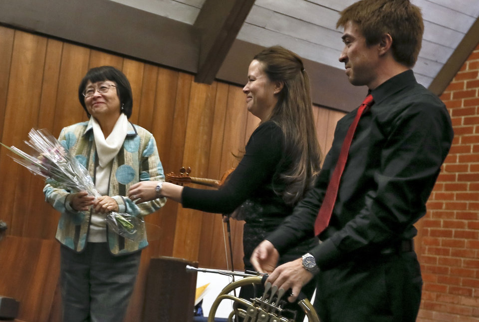 Ami Mariko Hood Frost and Kenji Scott Hood present their mother, Hiromi Hood, flowers during the Hood Family Recital.  Photo by Chris Landsberger, The Oklahoman <strong>CHRIS LANDSBERGER - CHRIS LANDSBERGER</strong>