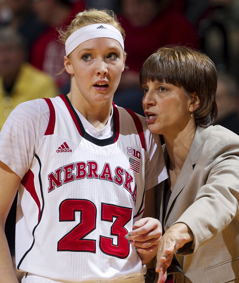 Photo - Nebraska head coach Connie Yori talks with Emily Cady during the second half of their NCAA college basketball game against Michigan State, Thursday, Jan. 24, 2013, in Lincoln, Neb. Nebraska won 59-54. (AP Photo/The World-Herald, Mark Davis) MAGS OUT; ALL NEBRASKA LOCAL BROADCAST TV OUT