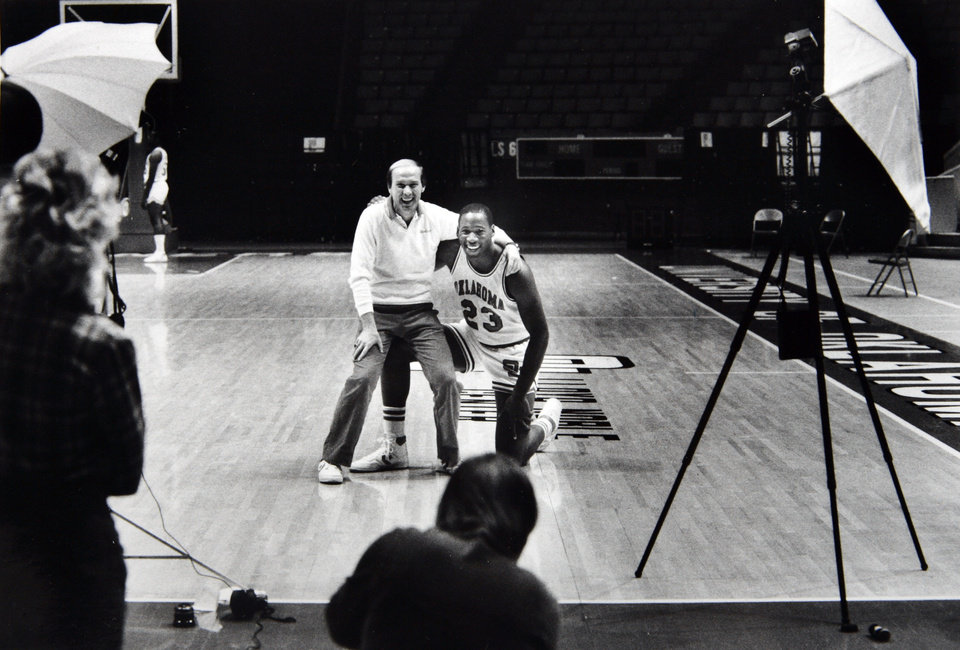 Photo - Former OU basketball player Wayman Tisdale. Wayman Tisdale poses with his favorite University of Oklahoma coach during OU's annual media day on Wednesday. Staff photo by Doug Hoke. Photo taken 11/7/1984, Photo published 11/8/1984 in The Daily Oklahoman. ORG XMIT: KOD
