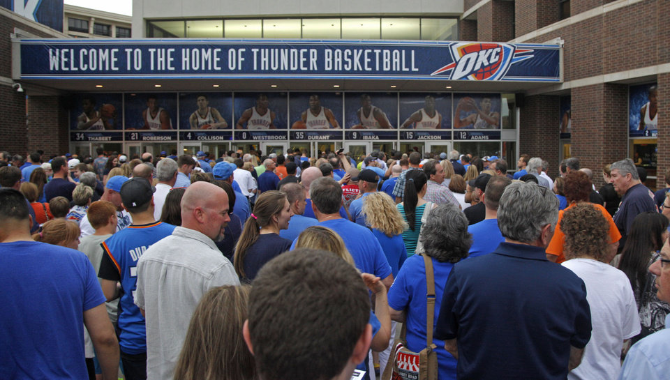 Photo - Fans wait to get in line before Game 2 of the Western Conference semifinals in the NBA playoffs between the Oklahoma City Thunder and the Los Angeles Clippers at Chesapeake Energy Arena in Oklahoma City, Wednesday, May 7, 2014. Photo by Bryan Terry, The Oklahoman