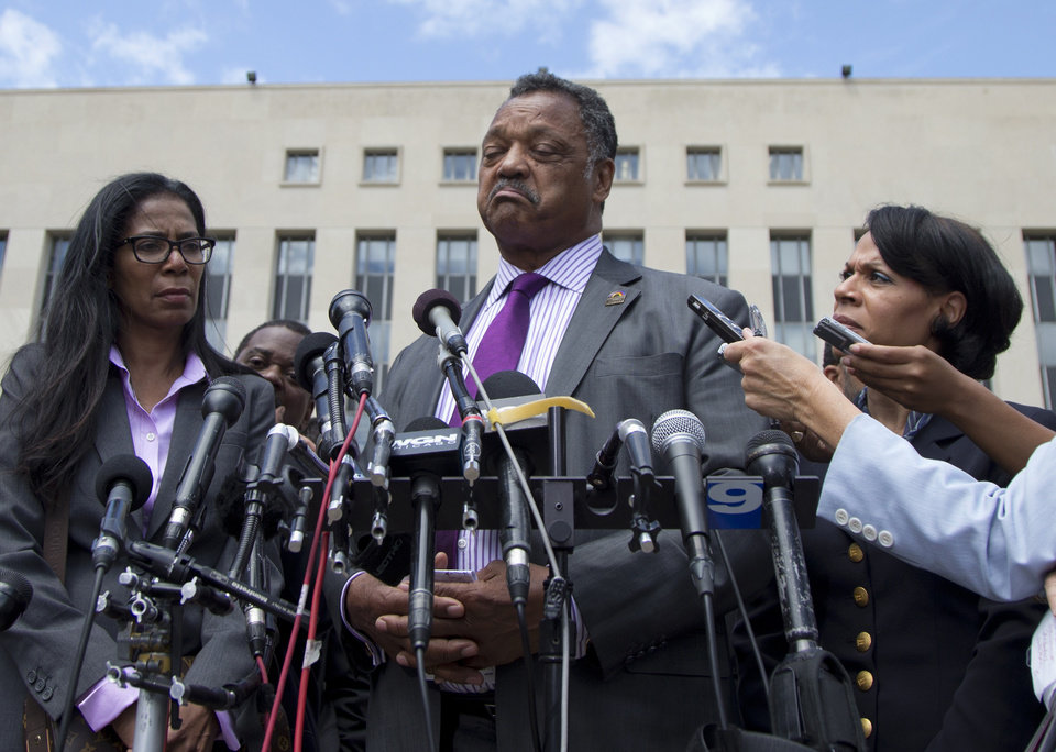 Photo - Rev. Jesse Jackson pauses as he he speaks to media outside federal court in Washington, Wednesday, Aug. 14, 2013, after his  son, former Illinois Rep. Jesse Jackson Jr., was sentenced to two and a half years in prison after pleading guilty to scheming to spend $750,000 in campaign funds on TV's, restaurant dinners, an expensive watch and other costly personal items. His wife Sandra Jackson received a sentence of one year. (AP Photo/Carolyn Kaster)