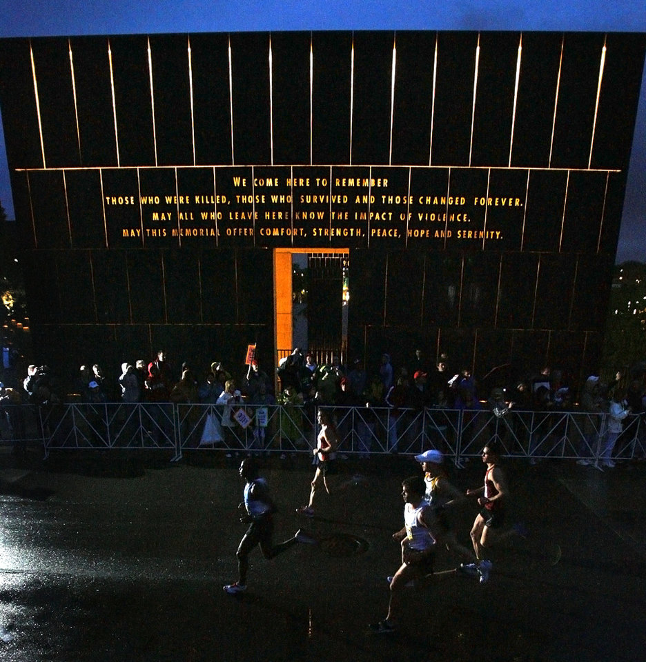 Photo - Marathon participants run past the Oklahoma City Bombing Memorial during the eighth annual Oklahoma City Memorial Marathon on Sunday , April 27, 2008, in Oklahoma City, Okla.   PHOTO BY CHRIS LANDSBERGER   ORG XMIT: KOD