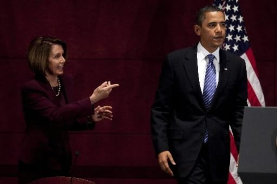 Photo - President Barack  Obama, right, stands with House Speaker Nancy Pelosi, D-Calif., during the House Democratic Caucus retreat at the U.S. Capitol on Thursday, Jan. 14, 2010, in Washington. (AP Photo/Evan Vucci)