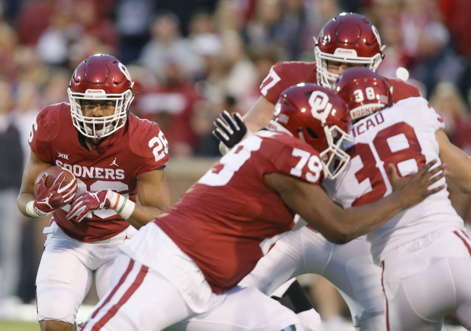 Photo - Oklahoma's Kennedy Brooks (26) carries the ball  during the University of Oklahoma (OU) spring football game at Gaylord Family-Oklahoma Memorial Stadium in Norman, Okla., Friday, April 12, 2019. Photo by Bryan Terry, The Oklahoman