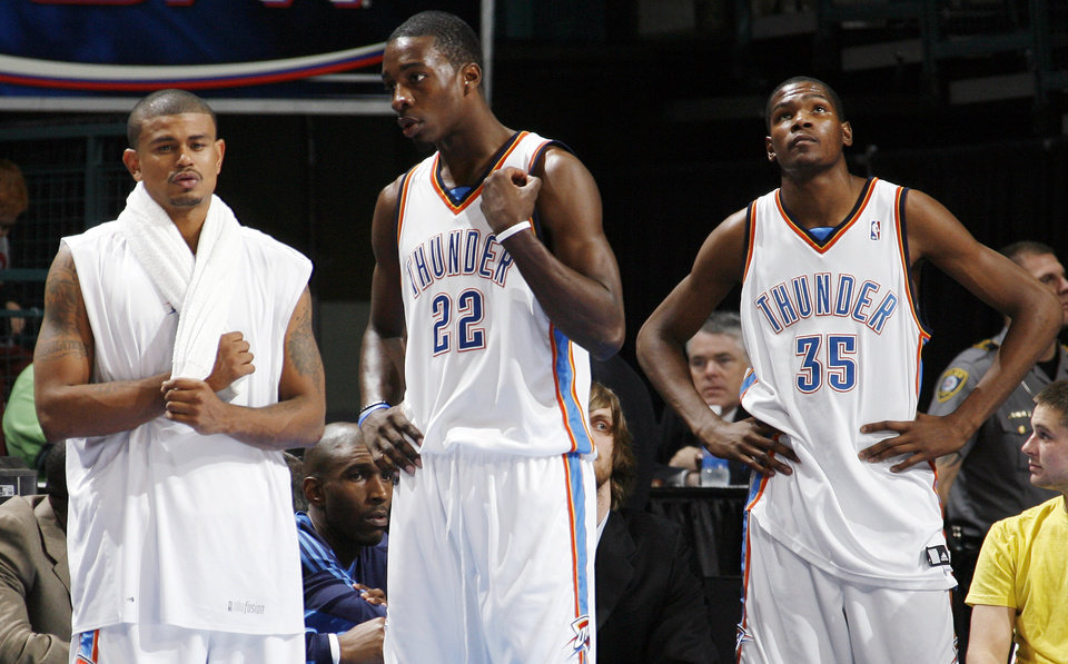From left, Earl Watson, Jeff Green and Kevin Durant of the Thunder stand in the bench area late in the fourth quarter of the NBA basketball game between the Oklahoma City Thunder and the Los Angeles Clippers at the Ford Center in Oklahoma City, Wednesday, Nov. 19, 2008. The Clippers won. 108-88. BY NATE BILLINGS, THE OKLAHOMAN