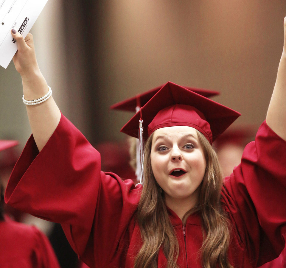 Photo - Blake Crabtree, 18, expresses her excitement about graduating from Edmond Memorial High School.  PHOTO BY JIM BECKEL, THE OKLAHOMAN  Jim Beckel - THE OKLAHOMAN