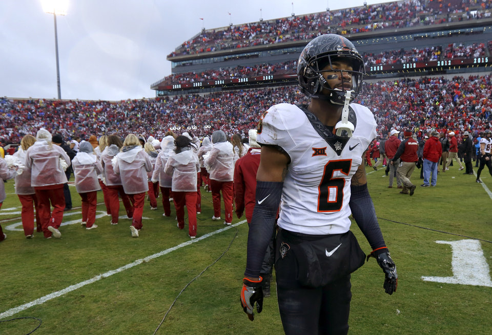 Photo - Oklahoma State's Ashton Lampkin (6) walks off the field after the Bedlam college football game between the Oklahoma Sooners (OU) and the Oklahoma State Cowboys (OSU) at Gaylord Family - Oklahoma Memorial Stadium in Norman, Okla., Saturday, Dec. 3, 2016. Oklahoma won 38-20. Photo by Bryan Terry, The Oklahoman
