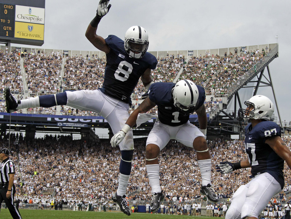 Photo -   Penn State running back Bill Belton (1) celebrates with teammates wide receiver Allen Robinson (8) and tight end Kyle Carter (87) after rushing for the first touchdown of the new season during the first quarter of an NCAA college football game against Ohio at Beaver Stadium in State College, Pa., Saturday, Sept. 1, 2012. (AP Photo/Gene J. Puskar)