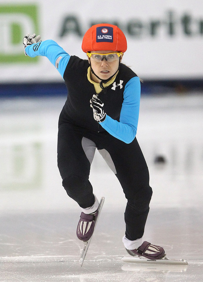 Jessica Smith competes in the women's 1,000 meters during the U.S. Olympic short track speedskating trials on Sunday, Jan. 5, 2014, in Kearns, Utah. (AP Photo/Rick Bowmer)