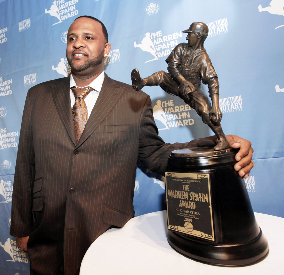 Photo - New York Yankee pitcher CC Sabathia poses with the Warren Spahn Award on Tuesday. Sabathia didn't merely survive his first year in pinstripes. He thrived. Photo by Nate Billings, The Oklahoman