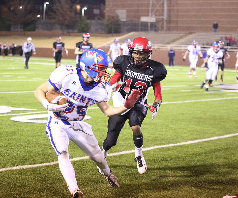 Photo - Oklahoma Christian School's Luke Frankfurt, left, carries the ball as Frederick's Aaron Nolan defends during Friday's Class 2A state semifinal in Weatherford on Nov. 30, 2012. PHOTO BY BRANDON NERIS, THE LAWTON CONSTITUTION