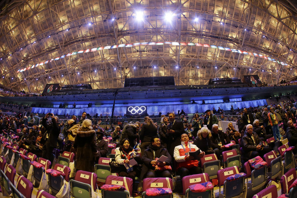 Photo - In a photo taken with a fisheye lens, spectators arrive at the Fisht Olympic Stadium prior to the start of the opening ceremony of the 2014 Winter Olympics in Sochi, Russia, Friday, Feb. 7, 2014. (AP Photo/Mark Humphrey)
