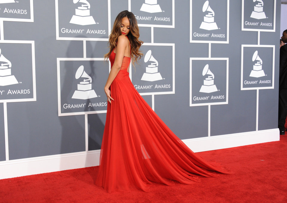 Photo - Rihanna arrives at the 55th annual Grammy Awards on Sunday, Feb. 10, 2013, in Los Angeles.  (Photo by Jordan Strauss/Invision/AP)