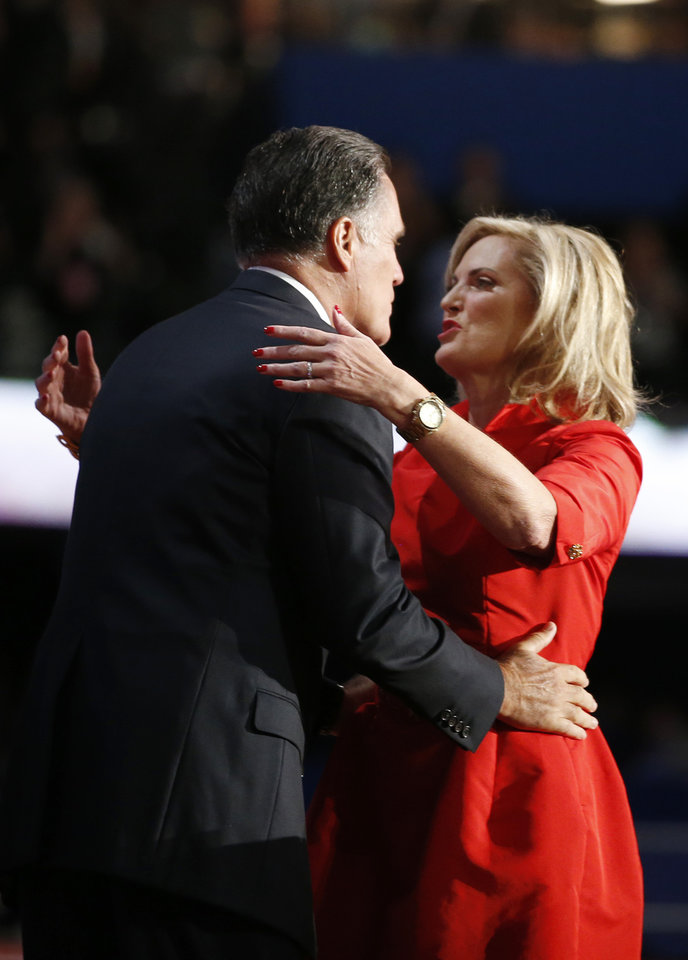 Photo -   Republican presidential nominee Mitt Romney hugs his wife Ann Romney on stage at the Republican National Convention in Tampa, Fla. on Tuesday, Aug. 28, 2012. (AP Photo/Jae C. Hong)
