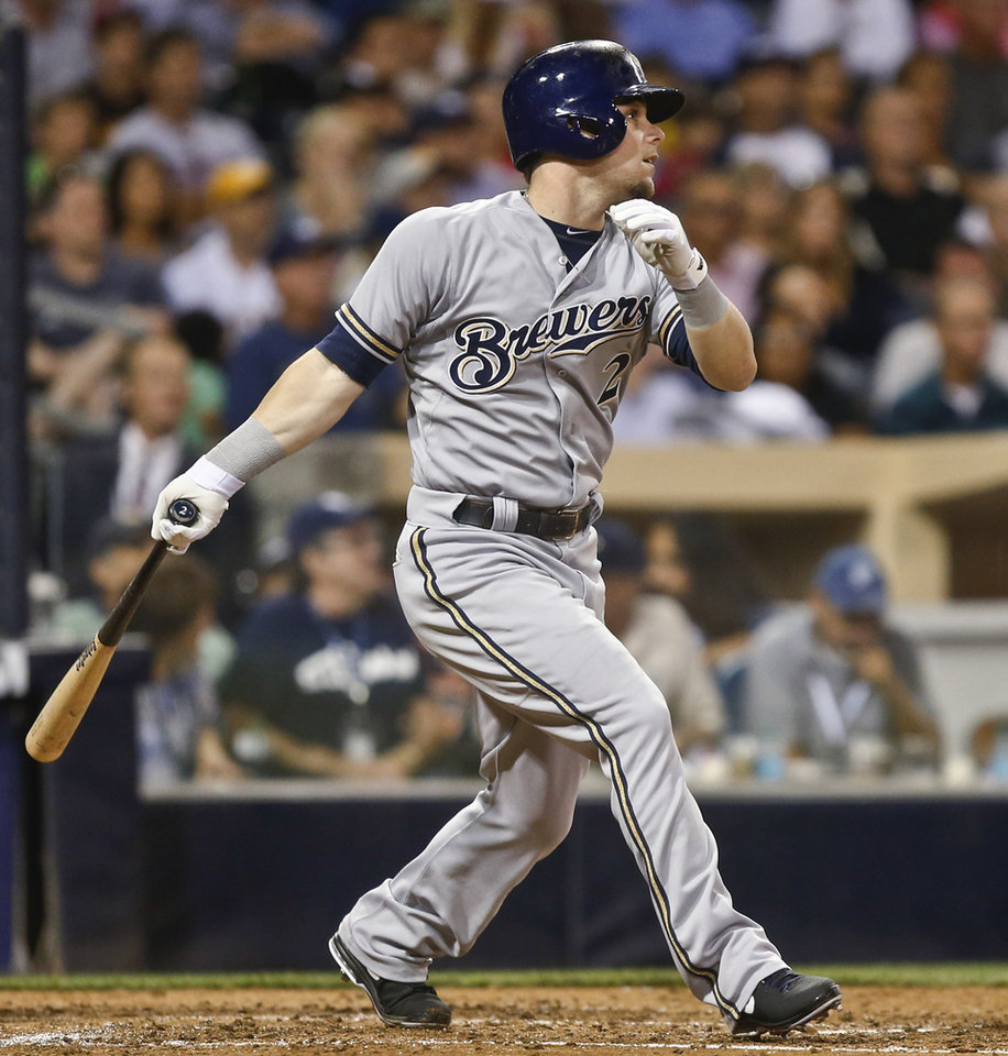 Photo - Milwaukee Brewers' Scooter Gennett  watches his double to center field that drives in Jonathan Lucroy in the fourth inning of a baseball game against the San Diego Padres on Tuesday, Aug. 26, 2014, in San Diego. (AP Photo/Lenny Ignelzi)