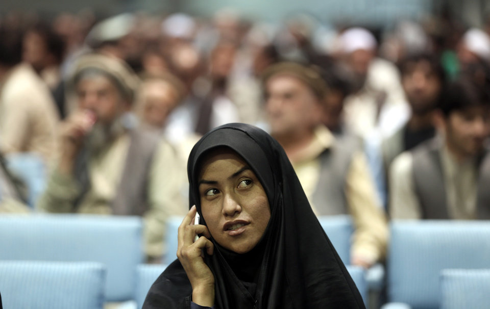 Photo - A supporter of Afghan presidential candidate Abdullah Abdullah, speaks on the phone during a gathering of his supporters in Kabul, Afghanistan, Tuesday, July 8, 2014.  Abdullah says he received calls from President Barack Obama and U.S. Secretary of State John Kerry after he refused to accept the preliminary result of the vote citing fraud. He told his supporters the results of the election were fraudulent but asked them to give him a few more days to negotiate. (AP Photo/Massoud Hossaini)