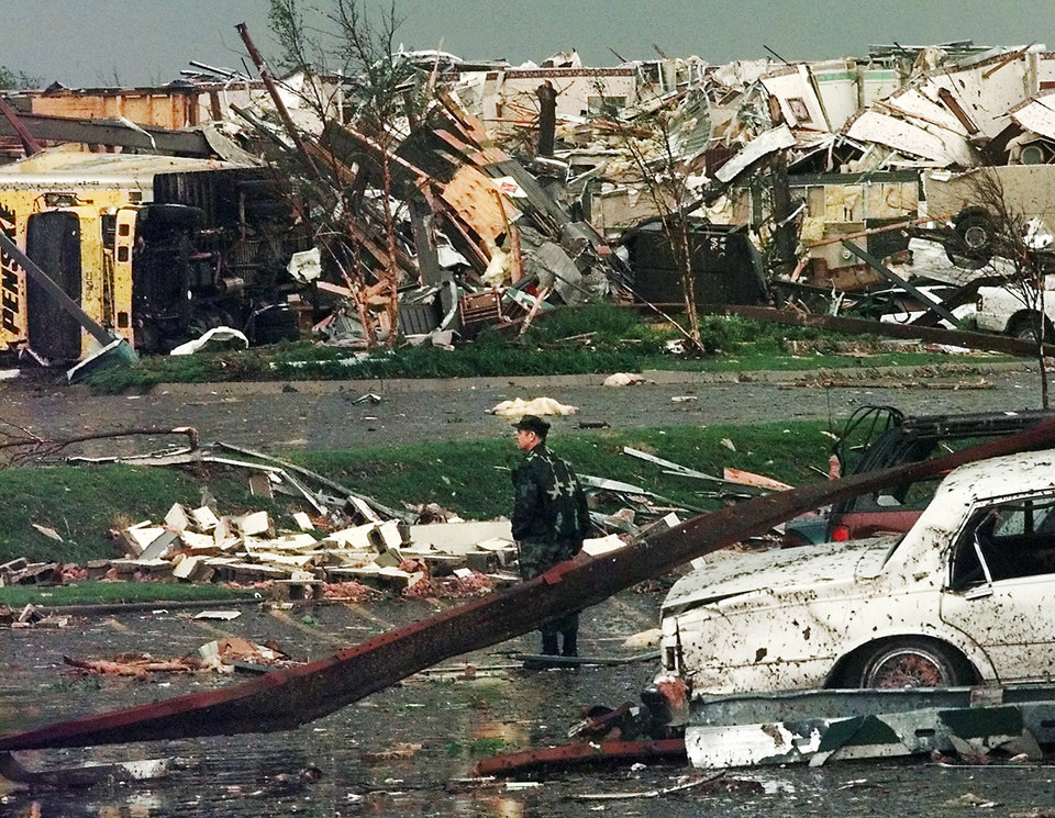 MAY 3, 1999 TORNADO / NATIONAL GUARD: Tornado damage: A National Guardsman stands in the parking lot of the Comfort Inn and surveys damage to another hotel, the Hampton Inn, in the background.  Both were destroyed in Monday night's tornado.