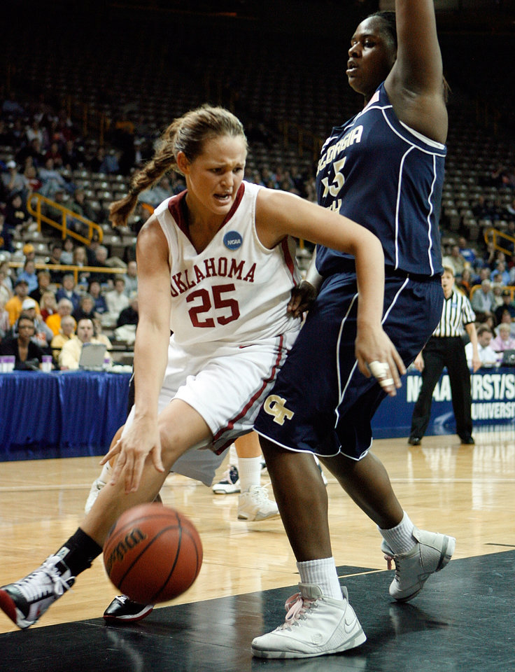 Photo - NCAA TOURNAMENT / WOMEN'S COLLEGE BASKETBALL: Whitney Hand tries to drive around Sasha Goodlett in the first half as the University of Oklahoma (OU) plays Georgia Tech in round two of the 2009 NCAA Division I Women's Basketball Tournament at Carver-Hawkeye Arena at the University of Iowa in Iowa City, IA on Tuesday, March 24, 2009.   PHOTO BY STEVE SISNEY, THE OKLAHOMAN ORG XMIT: KOD
