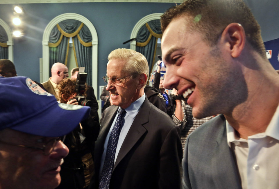 Photo - CORRECTS ID TO FRED WILPON, NOT JEFF WILPON - New York Mets owner Fred Wilpon, center, and Mets third baseman David Wright, right, smile after a news conference to outline the festivities for baseball's All-Star game on Wednesday, April 24, 2013 in New York. The Mets are hosting the All-Star game on July 16. (AP Photo/Bebeto Matthews)