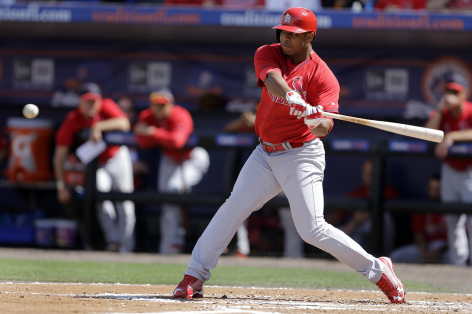 Photo - St. Louis Cardinals' Oscar Taveras hits a double during the second inning of an exhibition spring training baseball game against the New York Mets Friday, March 7, 2014, in Port St. Lucie, Fla. (AP Photo/Jeff Roberson)