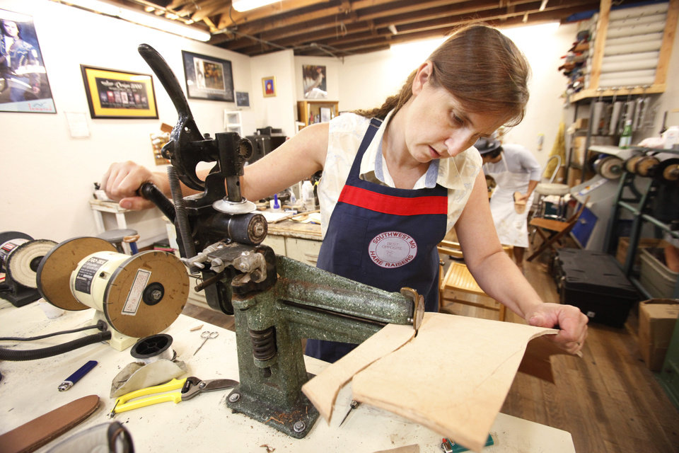 Marna Davis, from Hitchcock, OK, cuts out a sole for a shoe in a class at Sorrell Custom Boots in Guthrie, Thursday, July 19 , 2012. Photo By David McDaniel/The Oklahoman