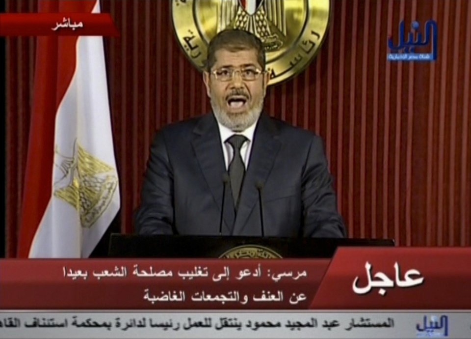 Photo - In this image made from video, Egyptian President Mohammed Morsi delivers a televised statement in Cairo, Egypt, Thursday, Dec. 6, 2012. (AP Photo/Nile TV) EGYPT OUT
