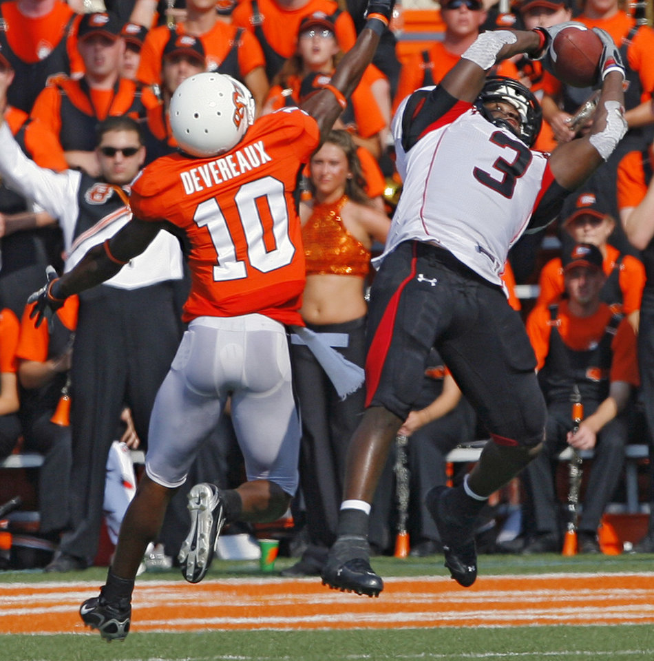 Photo - Texas Tech's Jamar Wall (3) pulls in an interception on a pass intended for Oklahoma State's Tommy Devereaux (10) during the first half of the college football game between the Oklahoma State University Cowboys (OSU) and the Texas Tech University Red Raiders (TTU) at Boone Pickens Stadium  on Saturday, Sept. 22, 2007, in Stillwater, Okla. 
